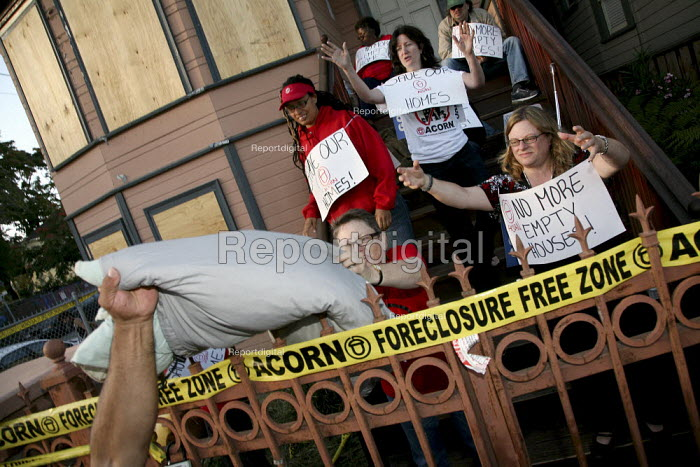 Home Defender activists sit in on the steps of the home of... - David Bacon, DNB0908repo11.jpg