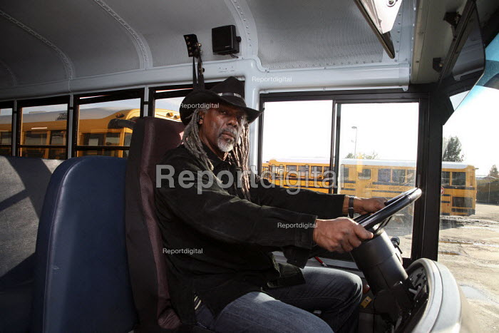 A school bus driver for the Sequoia Union High School District at the wheel of his bus. California - David Bacon - 2009-12-17