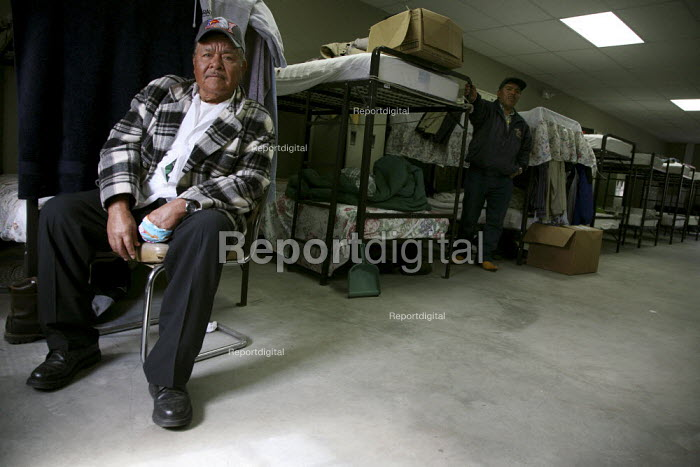 This worker has injured his hand. Migrant Mexican blueberry pickers. They live most of the year on bunkbeds in a dormitory on huge labor camp operated by Jasper Wyman, the world largest blueberry producer. Deblois - David Bacon - 2010-04-18