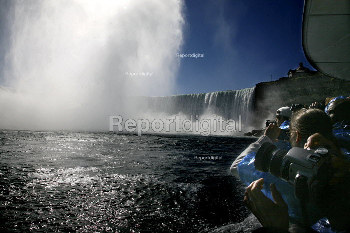 """Niagara Falls, from the Canadian side of the falls, called the Horseshoe Falls. A """"Maid of the Mist"""" boat carries tourists to the bottom of the falls. - David Bacon - 2010-10-16"""