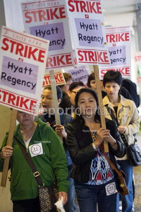 Hotel workers and their supporters picket at the Hyatt Regency Hotel, on the second day of a seven-day strike. The contract with the workers' union expired in June. Since then, Local 2 has been trying to bargain a new agreement. - David Bacon - 2011-09-13