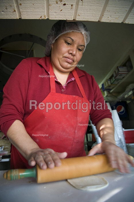 California, La Pasadita Taco Shop, making home-made flour tortillas with a rolling pin. It is the only restaurant in Seeley, an unincorporated community just outside the city limts of El Centro, Imperial Valley. - David Bacon - 2012-02-03