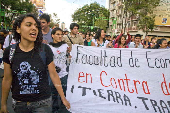 MEXICO CITY, Students from the National Autonomous University of Mexico (UNAM) join other students and workers in a march from the Plaza of Three Cultures (Tlatelolco) to Mexico Citys main plaza, the Zocalo, to conmemorate the massacre of hundreds of students by the army in 1968. Students, workers, unions and community organizations also protested the proposed reform of Mexicos labor law. - David Bacon - 2012-10-02
