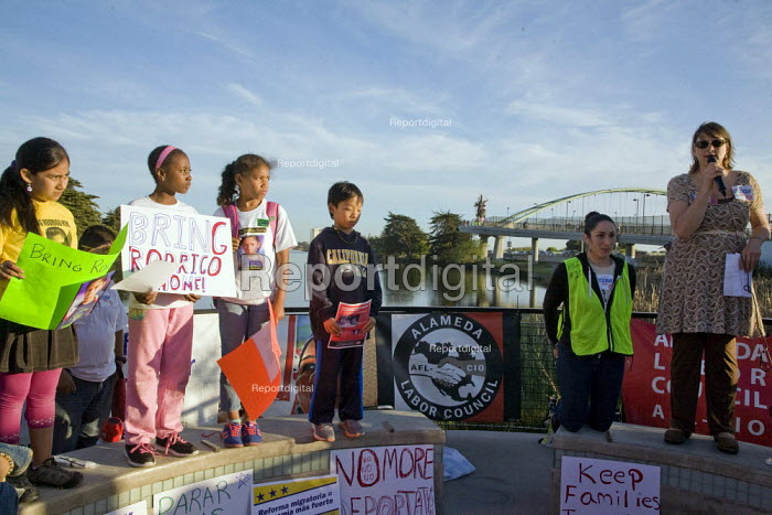 BERKELEY, California - Immigrant workers and their families and supporters rally and march in Berkeley, calling on Congress to pass immigration reform legislation. The demonstrators marched onto a bridge across the freeway. Children from Jefferson Elementary School spoke and carried placards asking the government to let Rodrigo Guzman, a fourth-grader deported with his family, return home to the USA - David Bacon - 2013-04-10