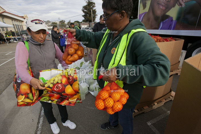 Oakland, California ?he hungry queue to obtain food from... - David Bacon, DNB1312s14.jpg