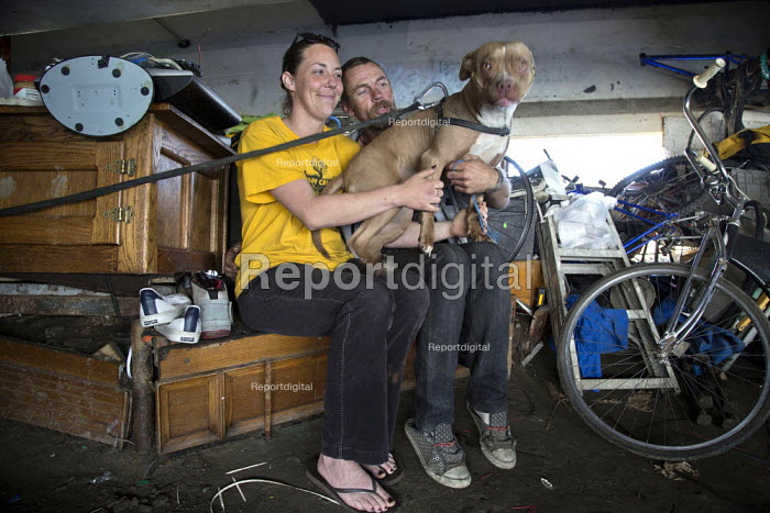 California: Jeremy and Kelly live with their dog under a bridge by the estuary, at the edge of the bay. - David Bacon - 2014-07-07