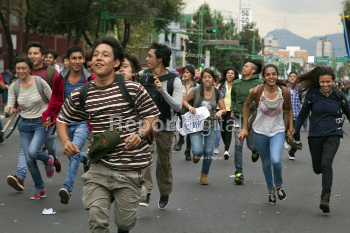 MEXICO CITY, MEXICO Students and workers march to comemorate the massacre of hundreds of students by the army in 1968 and the recent killings in Iguala. - David Bacon - 2014-10-02