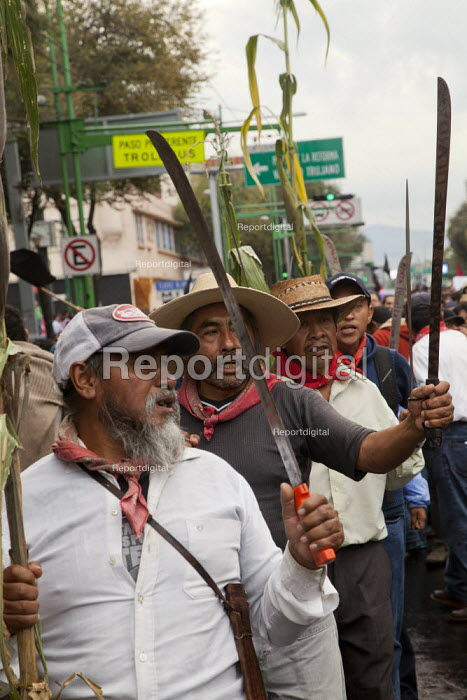 MEXICO CITY, MEXICO Farmers from Atenco, outside Mexico City holding up corn and machetes to protest at their eviction from their land to make way for a new airport development. Students and workers march to comemorate the massacre of hundreds of students by the army in 1968. - David Bacon - 2014-10-02