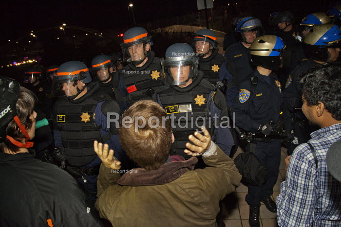 Berkeley, California Protestors face police in a demonstration against the murders of Black men by police around the country. - David Bacon - 2014-12-08
