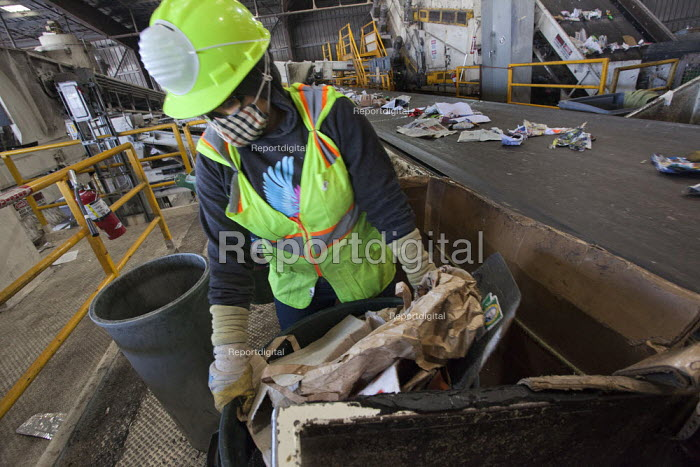 California- Workers sort and process paper, cardboard, plastic, glass and metal from waste collected in local cities. Alameda County Industries - David Bacon - 2015-02-18