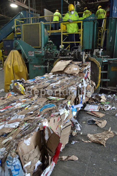 California- Workers sorting paper and cardboard from trash collected in Oakland. California Waste Solutions sorting facility. - David Bacon - 2015-02-19