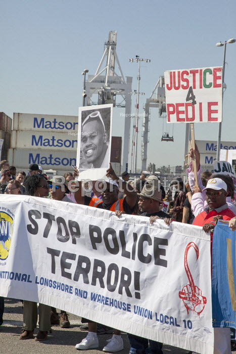 California Dockworkers ILWU and supporters rally and march in the Port of Oakland on May Day, to protest at the killing of young black men by police across the country. - David Bacon - 2015-05-01