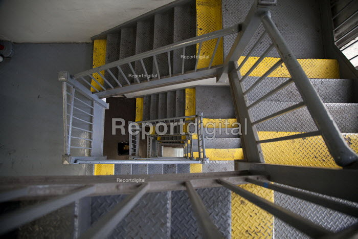 Yellow trip risk safety paint, stairwell in a loft building, New York City. USA - David Bacon - 2015-05-12