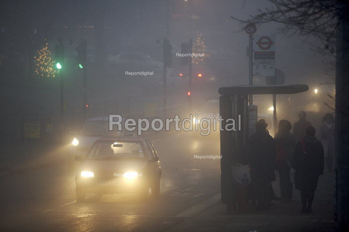 Shoppers waiting for the bus in heavy Fog, London. - Duncan Phillips - 2006-12-22
