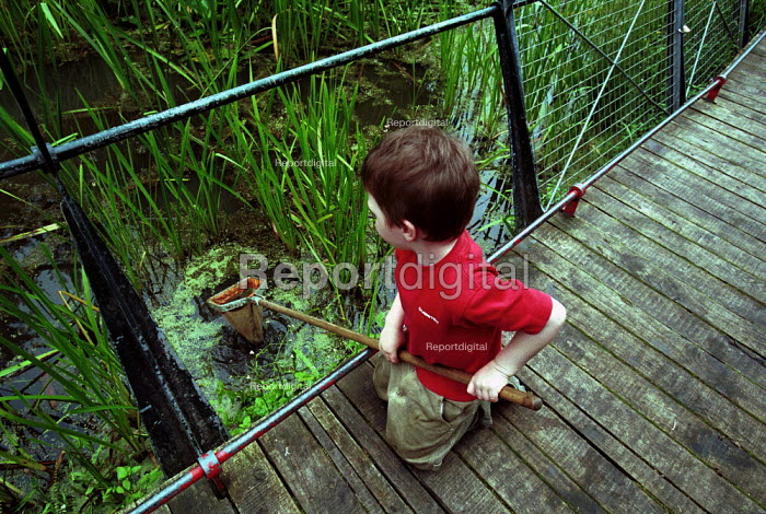 Child Pond Dipping at a Local Nature reserve Islington London - Duncan Phillips - 2002-08-12
