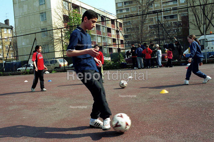 Boy practicing ball skills on a football training session Kings Cross London - Duncan Phillips - 2000-05-15