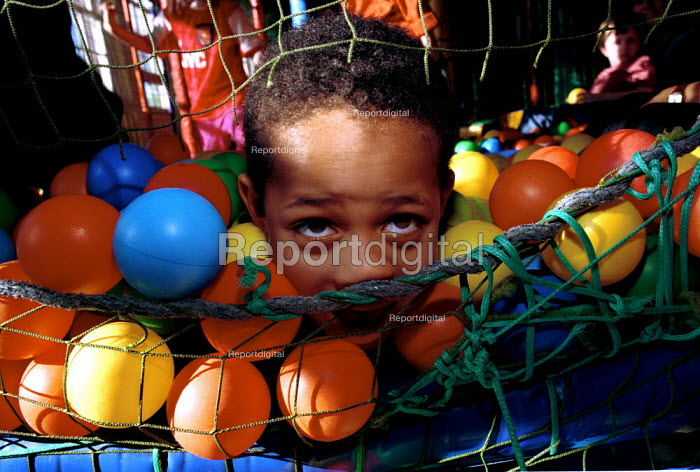 Autistic child at an indoor play centre - Duncan Phillips - 1999-04-05