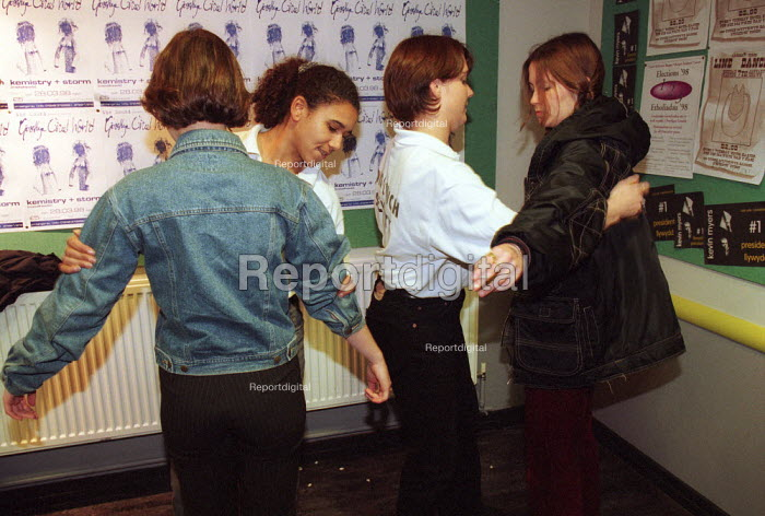 Nightclub security searching clubbers before entering a nightclub Bangor, Wales. - Duncan Phillips - 1999-05-30