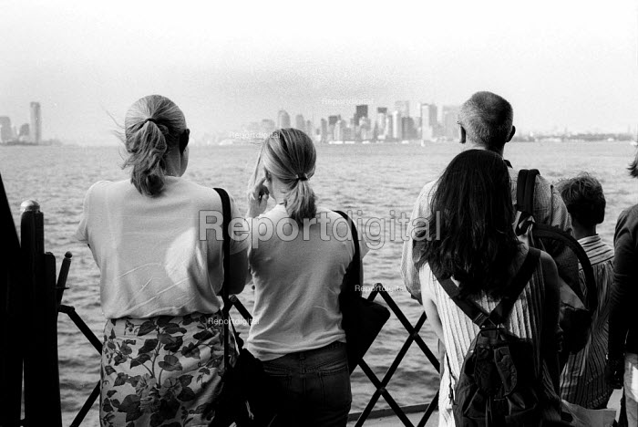 Passengers on the Staten Island Ferry with New York City in the Background. USA - Duncan Phillips - 2002-08-13