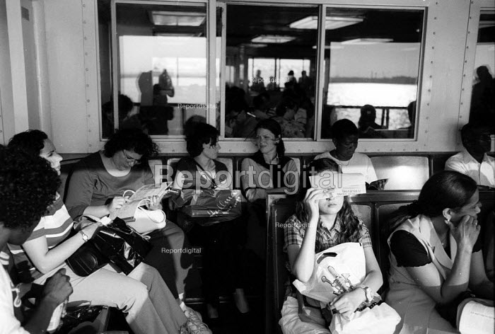 Passengers on the Staten Island Ferry with New york City in the Background.USA - Duncan Phillips - 2002-08-13