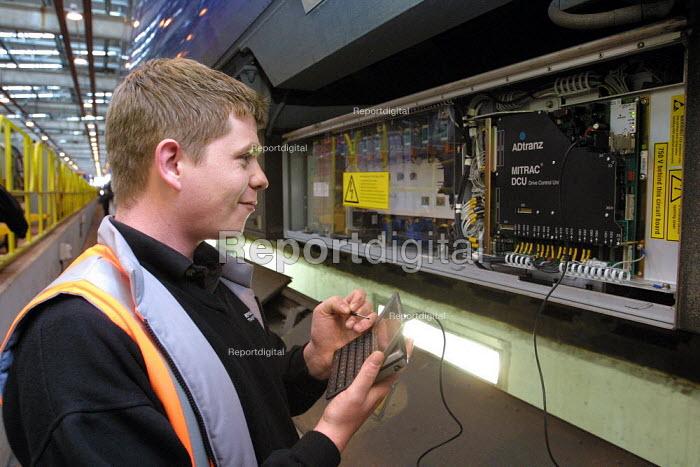 Apprentices training in mechanical maintenance on trains. Selhurst Depot, London - Duncan Phillips - 2003-01-23