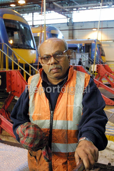 Worker involved in the Cleaning & mechanical maintenance of trains prior to being put into service. East Ham Depot, London. of trains prior to being put into service. East Ham Depot, London. - Duncan Phillips - 2003-01-23