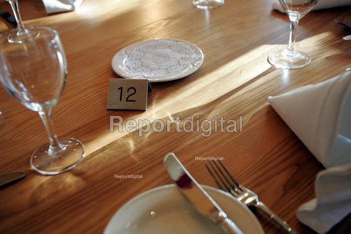 Wine glass in the sunlight on restaurant table - Duncan Phillips - 2004-11-09
