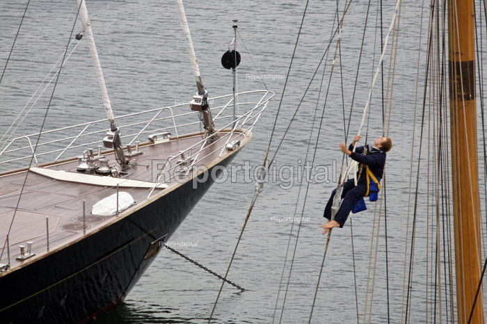 Sailor checking the rigging on a large yacht, Falmouth, Cornwall - Duncan Phillips - 2010-08-19