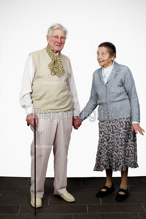 Retired married couple holding hands. - Duncan Phillips - 2010-11-07