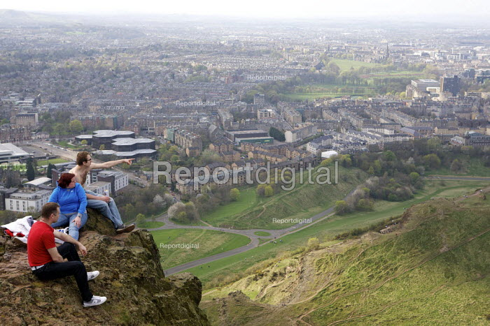 Walkers enjoying the panoramic view of the city, overlooking Edinburgh from Arthur's Seat - Duncan Phillips - 2011-04-10
