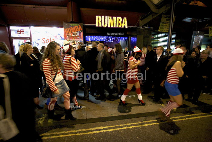 """Hen Party dressed up as """"where's Wally"""" character, fancy dress outside the Rumba Club and Bar, West End, London - Duncan Phillips - 2012-03-24"""