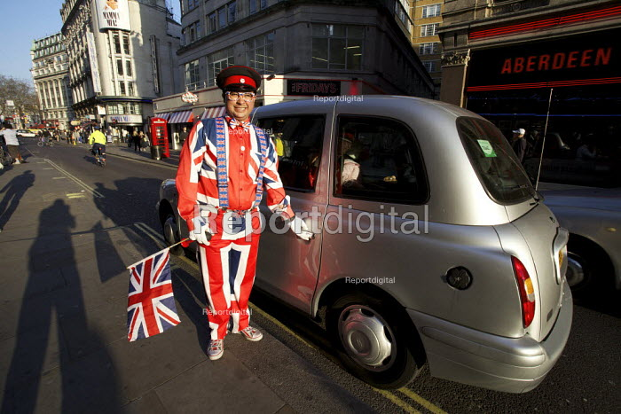 A concierge dressed in Union Jack suit welcoming tourists central London - Duncan Phillips - 2012-03-26