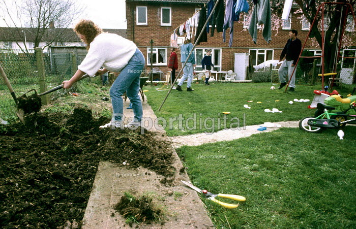 Family gardening and playing in their garden. - Duncan Phillips - 2005-07-15