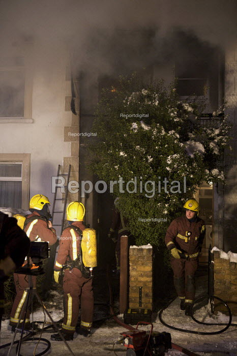 Firefighters with breathing apparatus attend a house Fire, Barnet, London - Duncan Phillips - 2010-01-07