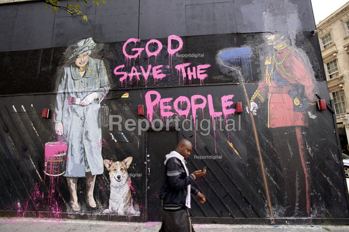 God save the people, street art with Quenn Elizabeth holding a can of pink paint and a paint brush, corgi dog and a Guardsman in a Bearskin hat, central London Thierry Guetta - Duncan Phillips - 2012-06-14