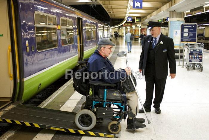 Disabled passenger leaving a train using a ramp, Euston Station, London - Duncan Phillips - 2005-05-25