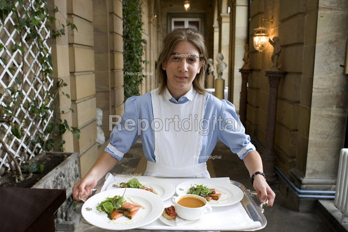 Waitress serving dinner in an english stately home. - Duncan Phillips - 2006-06-25