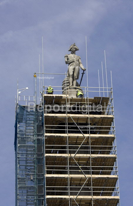 Scaffolding being removed from Nelson Column of Portland stone, l45 ft. high, erected by public subscription in 1840-43, from designs by Railton, after restoration work, Trafalgar Square, London - Duncan Phillips - 2006-07-12