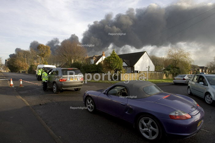 Plume of black smoke from the fire at Buncefield oil depot fire as police stop vehicles from entering the evacuated exclusion zone. - Duncan Phillips - 2005-12-13