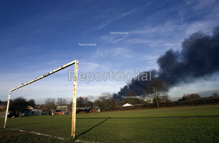 Plume of black smoke from the fire at Buncefield oil depot fire above a school playing field. - Duncan Phillips - 2005-12-13