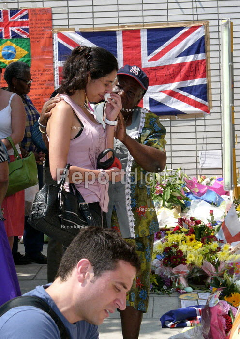 Upset Woman at Floral tributes Kings Cross station for the victims of terrorist attack,london. - Duncan Phillips - 2005-07-14