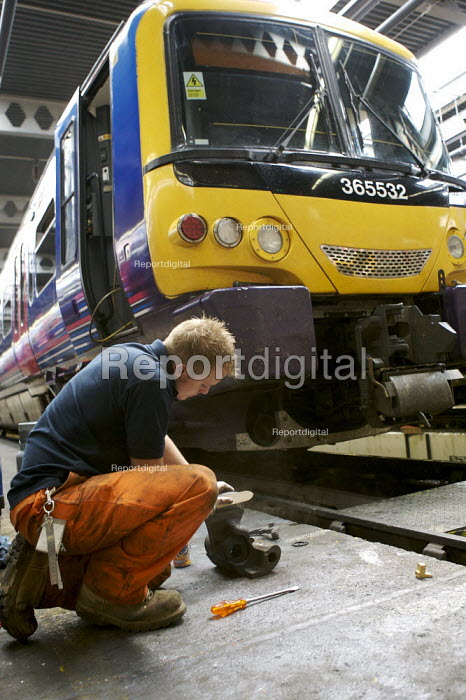 Mechanic working in train maintenance depot - Duncan Phillips - 2007-06-01