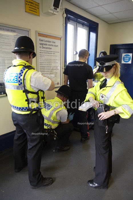 Railway enforcement officers and British Transport Police implementing a ticket blockade Plumbstead, London - Duncan Phillips - 2007-05-18