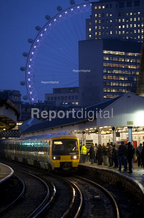Commuter train at Waterloo East Station London with the London Eye. - Duncan Phillips - 2008-11-06