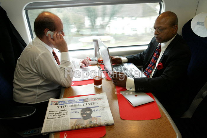 Businessmen travelling first class on a train - Duncan Phillips - 2004-03-15