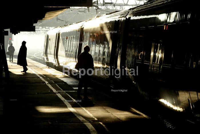 Passengers boarding a train in the early morning - Duncan Phillips - 2004-11-24