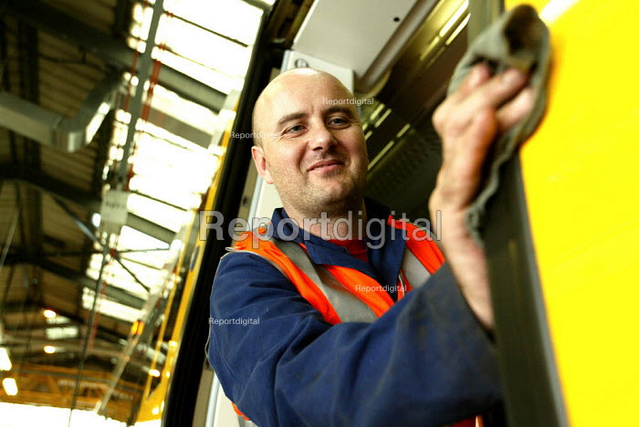 Mechanic working on a train at a maintanence depot. - Duncan Phillips - 2004-10-26