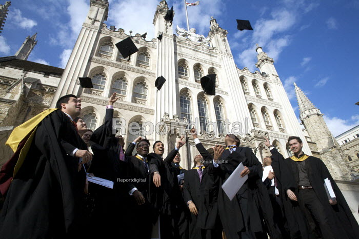 University Graduation, Guildhall, London. Throwing their mortarboards in the air. - Duncan Phillips - 2010-03-15