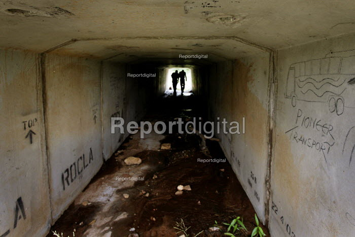 Beitbridge / South Africa Two men inspect a tunnel under a road outside Musina. Migrants use these places to live and sleep as they wait for a transport that will carry them to Pretoria or Johannesburg. - Felipe Trueba - 2007-11-25