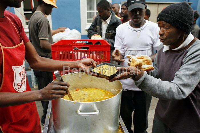 Johannesburg, South Africa.. Without any money to buy food many Zimbabweans depend on the help of charity organizations which distribute food for free in different places around Johannesburg. - Felipe Trueba - 2007-11-08